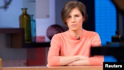 "Amanda Knox sits alone before being interviewed on the set of ABC's ""Good Morning America"" in New York, Jan. 31, 2014."