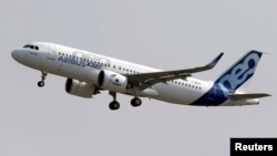 FILE - Normal rate of ascent for commercial jets like the Airbus A320 pictured is 300 to 600 meters per minute, an Indonesian official says; AirAsia Flight QZ8501, which crashed Dec. 28, was climbing about 1,800 meters per minute.