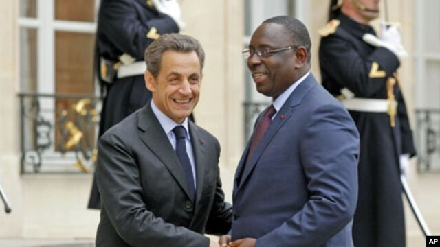 France's President Nicolas Sarkozy (L) greets Senegal's newly-elected President Macky Sall at the Elysee Palace in Paris, April 18, 2012.