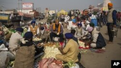 Protesting farmers prepare a meal for fellow farmers as they block a major highway during a protest at the Delhi-Haryana state border, India, Dec. 1, 2020.