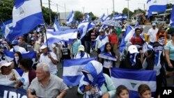 FILE - Anti-government marchers demand the resignation of President Daniel Ortega and the release of political prisoners in Managua, Nicaragua, July 22, 2018. The government said it released 636 prisoners Tuesday.