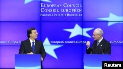 European Commission President Jose Manuel Barroso and European Council President Herman Van Rompuy (R) hold a news conference at the end of a European Union leaders summit in Brussels, Belgium, October 19, 2012.