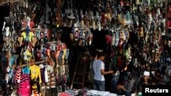 People shop at Al-Ataba, a popular market in downtown Cairo, Nov. 11, 2013.