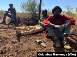Illegal miners resting at Nugget Mine in Matopo district.