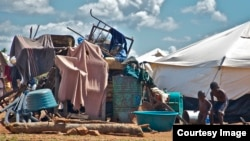 FILE: A pile of personal property left in the open at the Chingwizi transit camp. Hundreds of families lost their property during their relocation to the camp. (Photo: Human Rights Watch)