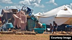A pile of personal property left in the open at the Chingwizi transit camp. Hundreds of families lost their property during their relocation to the camp. (File Photo: Human Rights Watch)