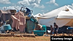 A pile of personal property left in the open at the Chingwizi transit camp. Hundreds of families lost their property during their relocation to the camp. (Photo: Human Rights Watch)