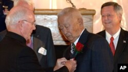 FILE - Ben Kuroki, a farm boy from Nebraska and the only Japanese-American believed to have flown over Japan during World War Two, receives the Distinguished Service Medal in Lincoln, Neb., from retired Gen. William J. Dendinger, left, Aug. 12, 2005.