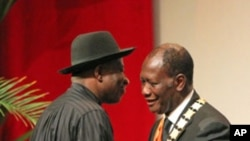 Ivory Coast President Alassane Ouattara (R) is greeted by Nigeria's President Goodluck Jonathan during his inauguration ceremony at the Felix Houphouet-Boigny Foundation in Yamoussoukro, May 21, 2011
