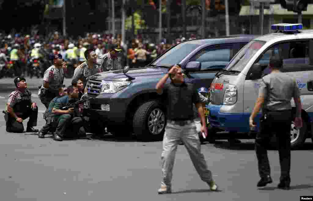 Several explosions went off and gunfire broke out in the center of the Indonesian capital and police said they suspected a suicide bomber was responsible for at least one the blasts.