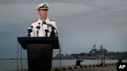 Commander of the U.S. Pacific Fleet Scott Swift answers questions during a press conference with the USS John S. McCain and USS America docked in the background at Singapore's Changi naval base in Singapore, Aug. 22, 2017.