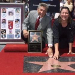 Patsy Cline's husband and daughter pose with the country music singer's star on the Hollywood Walk of Fame.