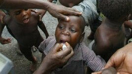 Child receiving polio vaccination (2004 photo)