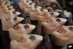 Carnival masks in the likeness of Brazil's President Dilma Rousseff are displayed at the Condal factory in Rio de Janeiro, Feb. 6, 2015.