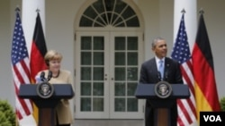 ຍາຍົກລັດຖະມົນຕີ ເຢຍຣະມັນ ທ່ານນາງ Angela Merkel (ຊ້າຍ) ແລະປະທານາທິບໍດີ ສະຫະລັດ ທ່ານ Barack Obama (ຂວາ)