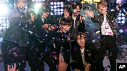 BTS perform at the Times Square New Year's Eve celebration on Tuesday, Dec. 31, 2019, in New York. (Photo by Ben Hider/Invision/AP)