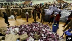Volunteers sort relief material to be distributed to flood victims in Chennai, India, Dec. 6, 2015. The worst flooding in a century in Tamil Nadu has left scores of people dead since November.