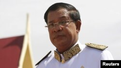 FILE - Cambodian Prime Minister Hun Sen attends the funeral ceremony of Chea Sim.