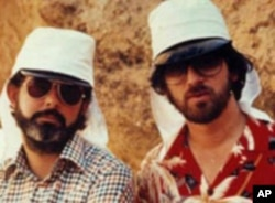 George Lucas and Steven Spielberg on the set of 'Raiders of the Lost Ark.' Both filmmakers say Norman Rockwell influenced their storytelling.