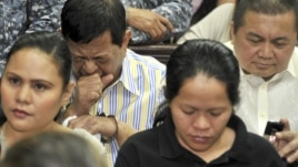 Former Maguindanao Governor Andal Ampatuan Sr. (back 2nd L) attends the arraignment of his electoral sabotage case at a regional trial court in Pasay, east of Manila, March 26, 2012.