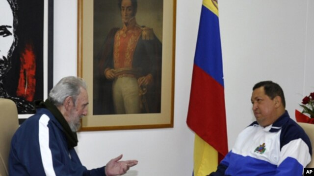 Cuba's former President Fidel Castro (L) visits Venezuela's President Hugo Chavez, who is recovering from surgery, in Havana, March 2, 2012.