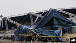 Indiana State Police and authorities survey the collapsed rigging and Sugarland stage on the infield at the Indiana State Fair in Indianapolis, August 14, 2011