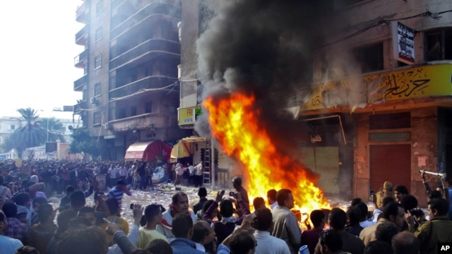 Protesters storm an office of Egyptian President Mohammed Morsi's Muslim Brotherhood Freedom and Justice party and set fires in the Mediterranean port city of Alexandria, Egypt, Nov. 23, 2012.