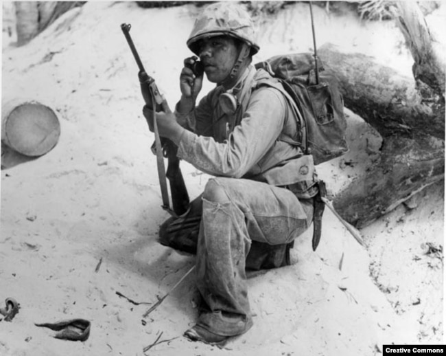 A Navajo Code Talker relays a message on a field radio. The code talkers served in the South Pacific during World War II and were kept a secret until 1968 when the code was finally declassified.