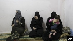 Syrian women refugees, who fled the violence in Syria, at their temporary home at the Al Hussein Palestinian refugees camp in Amman, Jordan, March 7, 2012