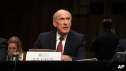 FILE - Director of National Intelligence Dan Coats prepares to testify before the Senate Intelligence Committee, on Capitol Hill in Washington, May 11, 2017. He is said to have been asked by President Donald Trump to disavow possible Russian collusion with his election campaign but refused to confirm such reports.