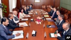 In this Press Information Department photo, Pakistan's adviser on foreign affairs, Sartaj Aziz, third from left, talks with Richard Olson, third from right, U.S. special representative for Afghanistan and Pakistan, in Islamabad, June 10, 2016.