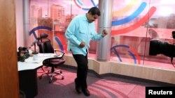 FILE - Venezuela's President Nicolas Maduro dances during his radio program at Miraflores Palace in Caracas, Venezuela.
