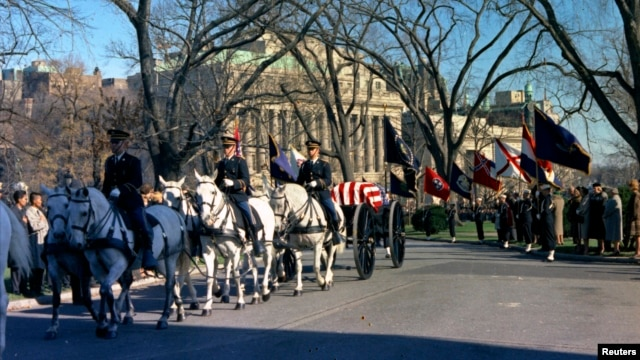 The funeral caisson carrying the casket of former U.S. President John F. Kennedy enters the White House driveway in Washington, in this handout image taken on Nov. 25, 1963.