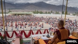 The Dalai Lama watching the performances at the TCV Choglamsar football ground in Ladakh