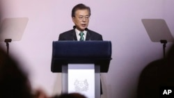 "FILE - South Korea's President Moon Jae-in delivers his speech entitled ""ROK and ASEAN: Partners for Achieving Peace and Co-prosperity in East Asia"" during the 42nd Singapore Lecture organized by the Institute of South East Asian Studies (ISEAS) in Singapore."