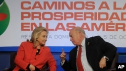 Secretary of State Hillary Rodham Clinton, left, talks to Secretary General of the Organization of American States Jos Miguel Insulza during a ministerial-level meeting of Pathways to Prosperity in the Americas, in Santo Domingo, Wednesday Oct. 5, 2011. (