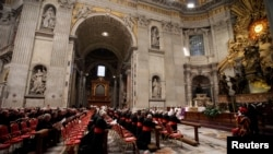 Cardinals pray at Saint Peter's Basilica in the Vatican, March 6, 2013.