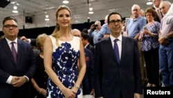 FILE - White House Senior Adviser Ivanka Trump and Treasury Secretary Steven Mnuchin (R) stand by prior to U.S. President Donald Trump's speech on tax reform at Loren Cook Company in Springfield, Missouri, Aug. 30, 2017.