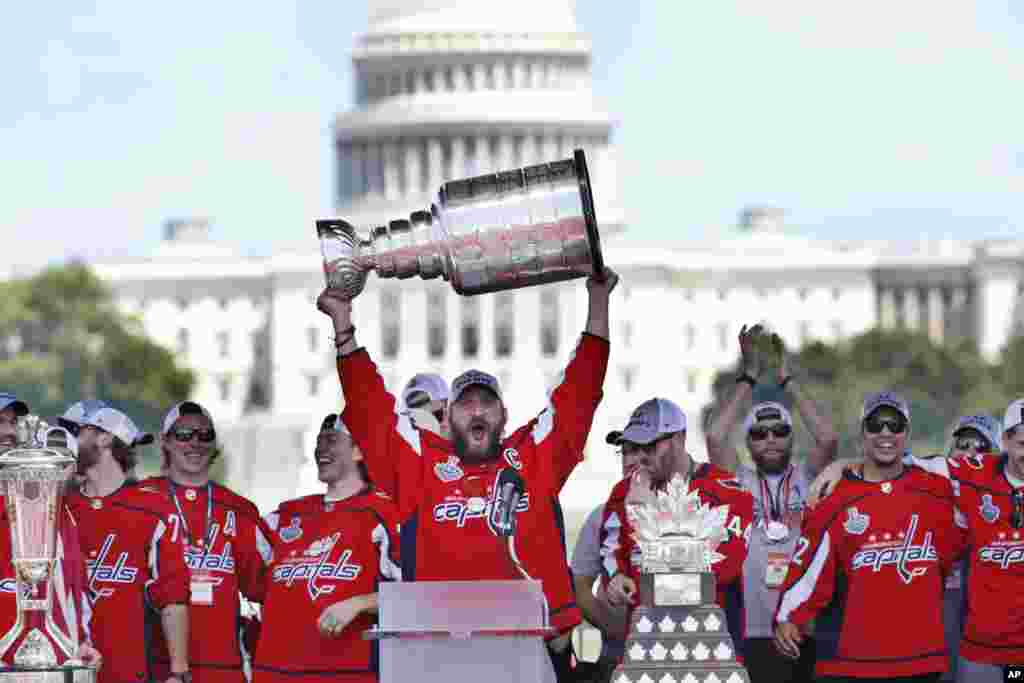 Washington Capitals' Alex Ovechkin of Russia holds up the Stanley Cup trophy during the NHL hockey team's Stanley Cup victory celebration at the National Mall in Washington.