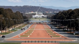 Australia's Parliament House (top) is visible above the old Parliament House (white building below) and Anzac Parade (foreground) in Canberra, (File photo).