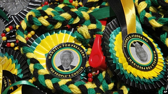A picture of former South African President Nelson Mandela is seen on memorabilia sold in Bloemfontein. South Africa's ruling African National Congress (ANC) celebrates its 100th birthday on Sunday, January 6, 2012.