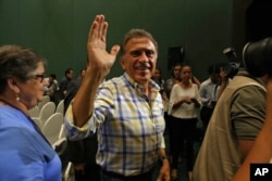 FILE - Miguel Angel Yunes waves at supporters as he arrives to a news conference in Veracruz, Mexico, on June 5, 2016. Hobbled by corruption scandals, violence and a weak economy, the ruling Institutional Revolutionary Party lost four states including Veracruz.