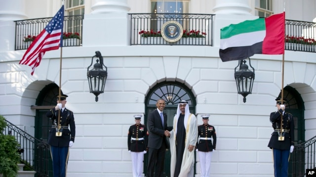 FILE - President Barack Obama, left, shakes hands with Sheikh Mohamed bin Zayed Al Nahyan, Crown Prince of Abu Dhabi, Deputy Supreme Commander of the UAE Armed Forces and Chairman of the Executive Council of the Emirate of Abu Dhabi, as he arrives at the