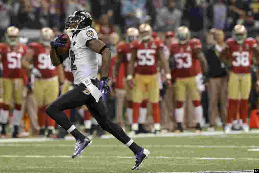 Baltimore Ravens wide receiver Jacoby Jones (12) runs the second-half opening kickoff back for a touchdown against the San Francisco 49ers in the NFL Super Bowl XLVII football game, Sunday, Feb. 3, 2013, in New Orleans.