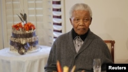 Former South African president Nelson Mandela observes his 94th birthday at his house in Qunu, Eastern Cape, July 18, 2012.