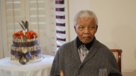 In this file photo, former South African president Nelson Mandela is shown observing his 94th birthday at his house in Qunu, Eastern Cape, July 18, 2012.