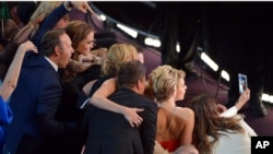 "Kevin Spacey, from left, Angelina Jolie, Julia Roberts, Brad Pitt, Jennifer Lawrence, Ellen DeGeneres and Jared Leto join other celebrities for a ""selfie"" during the Oscars at the Dolby Theatre on March 2, 2014, in Los Angeles."