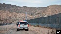 FILE - A U.S. Border Patrol agent patrols Sunland Park along the U.S.-Mexico border next to Ciudad Juarez, Jan. 4, 2016.