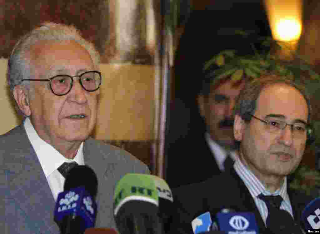 U.N.-Arab League peace envoy for Syria Lakhdar Brahimi (L) speaks next to Syria's Deputy Foreign Minister Faisal Mekdad during a news conference, after meeting Syria's President Bashar al-Assad, in Damascus October 21
