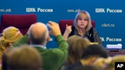 FILE - Ella Pamfilova, head of the Russian Central Election Commission, facing camera, speaks at commission headquarters in Moscow, Russia, Sept. 15, 2016.